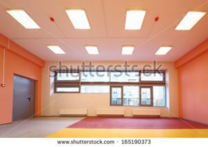 stock-photo-empty-gym-with-orange-walls-and-large-windows-in-the-kindergarten-165190373